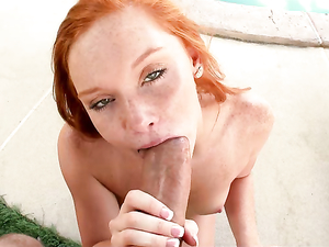 Freckled Redheaded Cutie Covered In A Big Cumshot